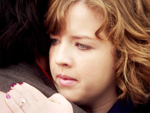 File:Clare Hugging Eli In Their Degrassi Uniforms With A Concerned Look On Clare's Face.jpg