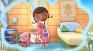 Doc hugging pink teddy bear