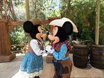 Disneyland Mickey and Minnie kiss as cowboys