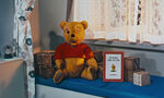 Winnie the Pooh is a real stuffed bear who winked at us