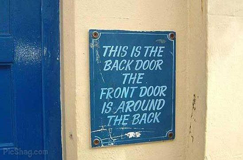 File:Confusing-sign-back-door.jpg
