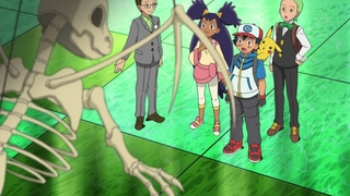 Archivo:EP674 Protagonistas mirando fosil de Dragonite.jpg