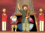 EP408 Tyson con el trofeo de la Liga Pokémon.png
