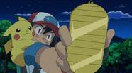 EP795 Ash encontrando una moneda amuleto.png
