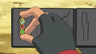 Archivo:EP673 Ash colocando su 1° medalla en el estuche.jpg