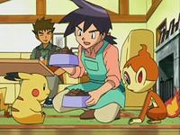 EP535 Reggie atendiendo a los Pokémon