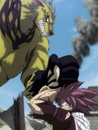 Etherious Jackal attacks Natsu