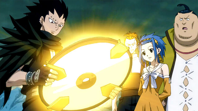 File:Gajeel and co see the Clock Part glow.jpg