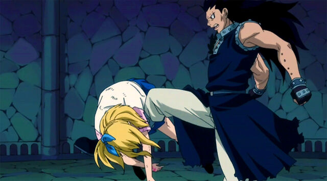 File:Gajeel checks is Lucy still alive.jpg