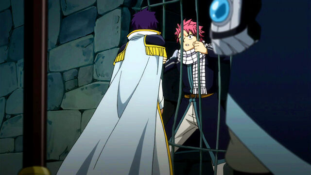 File:Hughes tells Natsu and Wendy about Happy and Carla's mission.jpg
