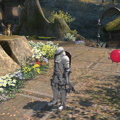 A player with his Wind-up Dalamud minion floating by his side.