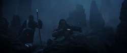 Baze aims his gun on Eadu.png