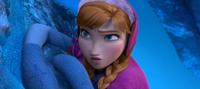 Anna climbing the cliff