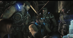 Baird, Marcus, Cole, Anya and Hoffman around the hologram