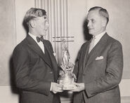Eddie August Schneider on September 27, 1930 accepting the Great Lakes Trophy in Detroit, Michigan (600 dpi, 95quality, cropped)