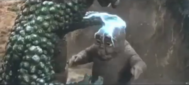 File:All Monsters Attack 5 - Gabara beats up Minilla.png