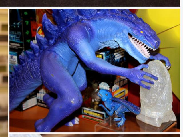 File:Godzilla nursing himself image.png