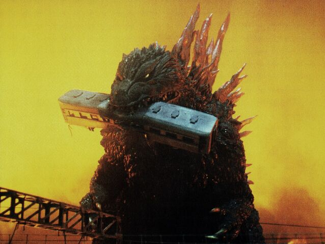 File:GXM - Godzilla Bites On a Train.jpg