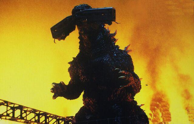 File:GXM - Godzilla Chomps On Train.jpg