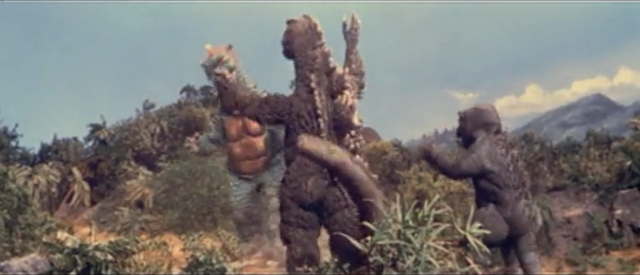 File:All Monsters Attack - Godzilla escapes the shocking attack.png