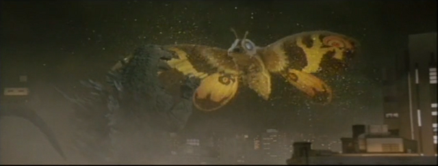 File:Mothra attacks Godzilla with scales.png