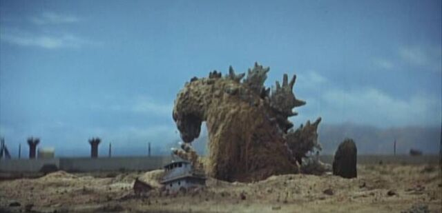 File:Godzilla -MosuGoji- rises from the ground.jpg