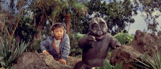 File:All Monsters Attack - Minilla gets excited over the stock footage.png