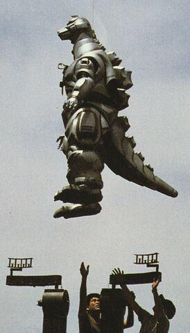 File:GVMG2 - Lifting the MechaGodzilla Suit.jpg
