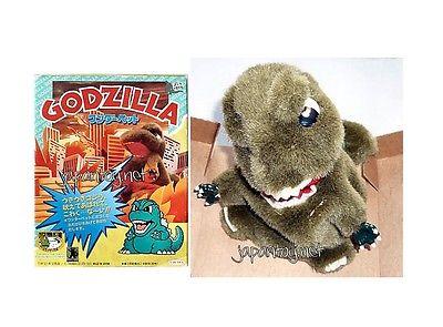 File:Stuffed animal Godzilla with bookimage.jpeg