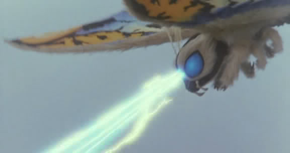 File:Rainbow Mothra fire his Multicolored Cross Heat Rainbow Laser Beams.jpg
