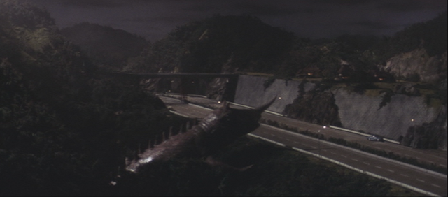 File:Gamera - 2 - vs Barugon - 22 - Barugon freezes Gamera so he goes on to a highway.png