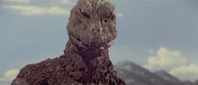 File:All Monsters Attack - Godzilla is interested in something.png