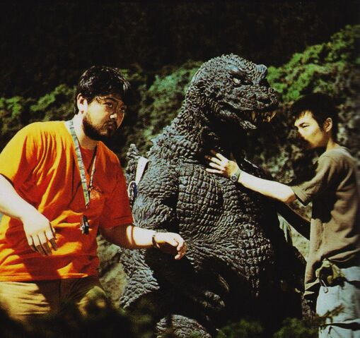 File:GMK - Godzilla and Two Men.jpg