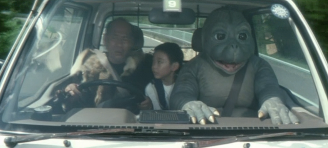 File:Godzilla Final Wars - 4-3 Minilla in the Passanger Seat.png