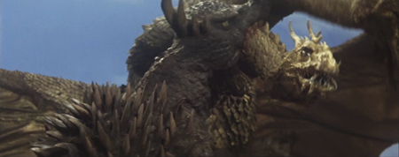 File:SoshingekiAngira Anguirus bites ShodaiGhido King Ghidorah in Destroy All Monsters DAM.jpeg