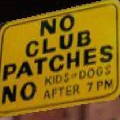 NO KIDS-DOGS AFTER 7 PM, sign at the Greasy Chopper..