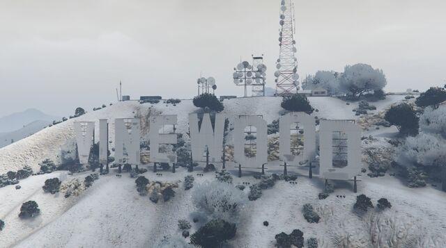 File:VinewoodSign-GTAO-Snow.jpg