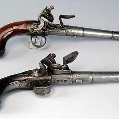 Two flintlock pistols.