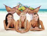 Mimmi, Sirena And Ondina Lying On Sand