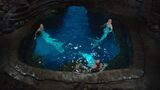 Nixie, Lyla, and Sirena sitting in the Moon Pool