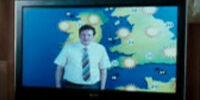Unidentified TV weatherman