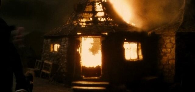 File:Hut on fire.jpg