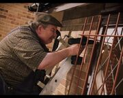 Vernon Dursley installs bars
