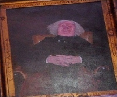 File:Unidentified resting headmaster below the portrait right.jpg