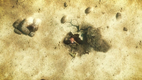 Lenny digging a grave in a desert