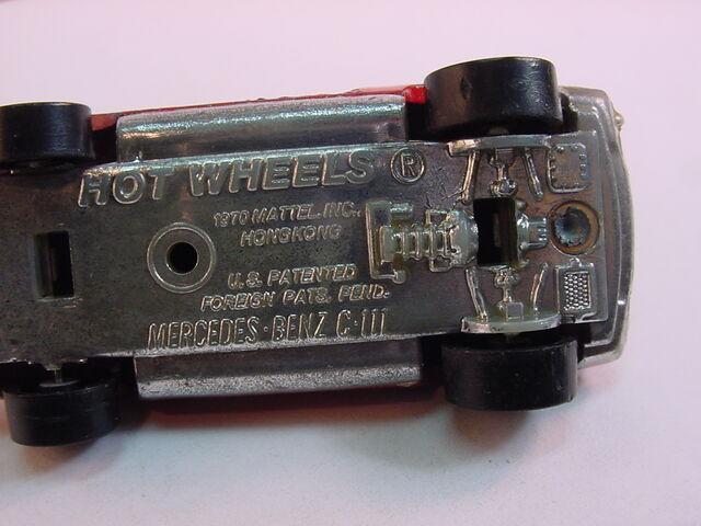 File:1974 Mercedesbenzc111 chrome plastic base-base view.JPG