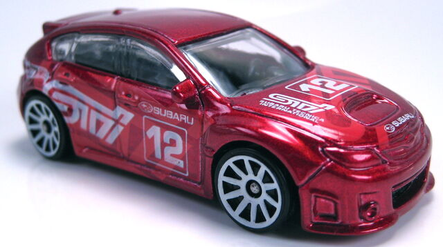 File:Subaru WRX STi red mtallic 2012 new models.JPG