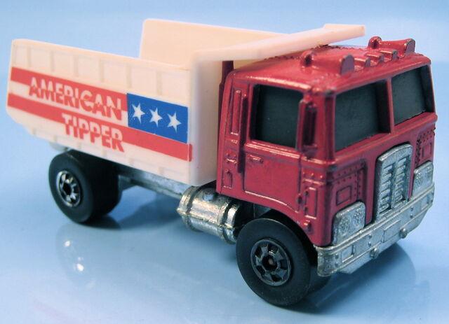 File:American tipper red enamel cab BW white dump HK base.JPG
