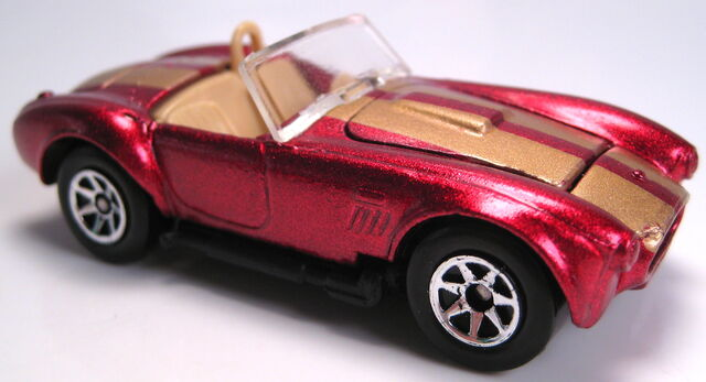 File:Classic Cobra met red gold stripes 7sp black plastic base 1995.JPG