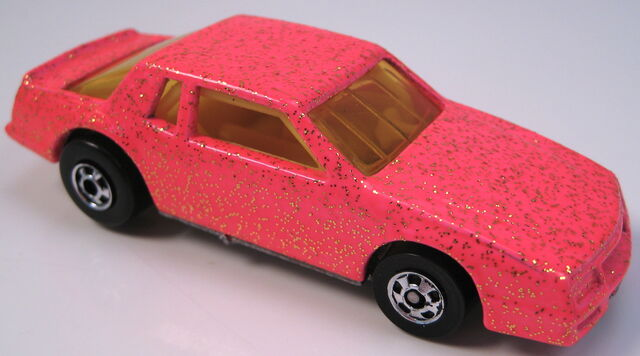 File:Chevy Stocker neon pink with gold glitter bw yellow interior yellow tint glass.JPG